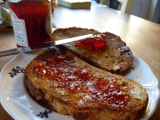 Homemade crab apple jelly on buttered not-homemade toast... mmm.